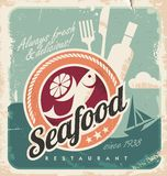 Vintage poster for seafood restaurant. Retro vector old paper background with fish and food. Old fashioned graphic design Stock Photo