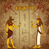 Vintage poster set with egyptian god, pharaoh and fan on the grunge background with silhouettes of the ancient egyptian hieroglyph Stock Image