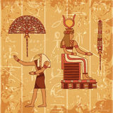 Vintage poster set with egyptian god, pharaoh, feather and fan on the grunge background with silhouettes of the ancient egyptian h Royalty Free Stock Photos