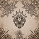 Vintage poster with Tribal mask on the grunge background over ornate pattern. Royalty Free Stock Image