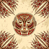 Vintage poster with Tribal mask on the grunge background over ornate pattern. Stock Photos