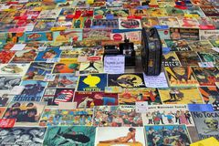 Vintage retro posters and polaroid camera at the flea market, Valencia, Spain. Every sunday there is an open air flea market at Plaza Redonda in Valencia. Spain Stock Photography
