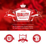 Vintage premium labels set on tile structured layout and blurred background Stock Photography