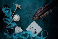 Vintage. Preparation for the holiday - the old iron, Christmas decorations - lace, star, ball, bump. top view Stock Photo