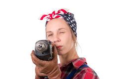 Vintage pretty young woman with a drill Stock Image