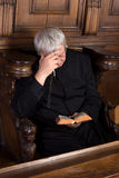 Priest with rosary Royalty Free Stock Photo