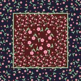 Vintage print bandana with pink flowers on a dark background. Royalty Free Stock Photo