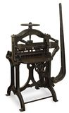 Vintage Printing Press. Vintage cast iron printing press, isolated on white with clipping path royalty free stock photo