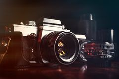 Vintage professional cameras and lenses. Vintage professional film cameras and lenses Stock Photos