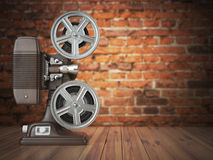Vintage projector on the bricks background. Cinema, movie or vid Royalty Free Stock Photo