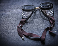 Vintage protective goggles on wood board Royalty Free Stock Photography