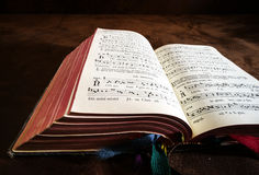 Vintage psalm book with chorus singing notes Stock Photos