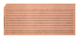 Vintage punched card isolated on white,. Vintage punched card isolated on white background, retro technology details Stock Photo