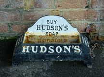 Vintage Puppy drinking trough, sponsored by Hudson`s Soap. Antique dog water trough, dating to approximately 1900-1910. This trough or bowl is made out of cast stock photos