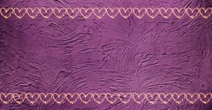 Vintage purple background with borders of hearts.
