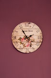 Vintage purple clock. Vintage clock on purple wall background Royalty Free Stock Images