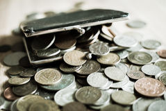 Vintage purse full of old coins. Stock Photos
