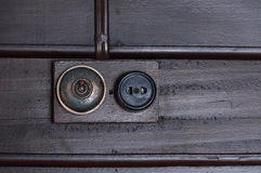 A Vintage put light switch on wooden interior wall Royalty Free Stock Photos