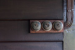 A Vintage put light switch on wooden interior wall Stock Photos