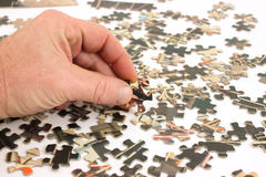 Vintage puzzle pieces with man's hand Royalty Free Stock Images