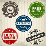 Vintage quality stamps label on old paper. From background. Vector illustration. Layered Royalty Free Stock Photos