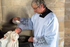 Vintage que bautiza al bebé Imagenes de archivo