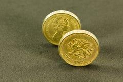 Vintage que mira monedas de libra británica; moneda del Reino Unido fotografía de archivo libre de regalías