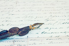 Vintage quill pen and antique letter Stock Image
