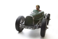 Vintage race car. Vintage toy race car with mustache driver Royalty Free Stock Image