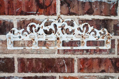 Vintage rack on red brick wall Royalty Free Stock Image