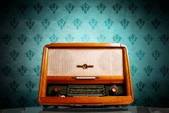 Vintage radio. On blue background stock photography