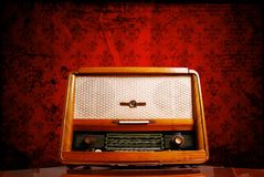 Vintage radio. On red background Stock Image