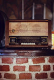 Vintage radio. On wooden table and bricks Royalty Free Stock Images