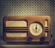 Vintage Radio. Antique radio on retro background Stock Photo