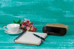 Vintage radio with book note on wood. Background royalty free stock photography