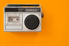 Vintage radio and cassette player on colour background. Flat lay, top view. retro technology stock photos