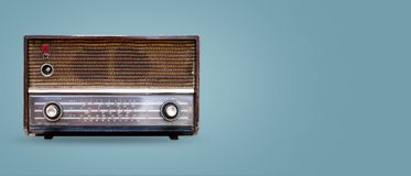 Vintage radio on color background. Stock Images