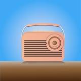 Vintage radio. Flat vintage radio on the table Royalty Free Stock Photo