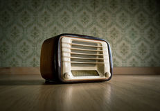 Vintage radio on the floor Royalty Free Stock Photography