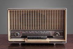 Vintage radio on grey background. Italian vintage radio on grey background Royalty Free Stock Images