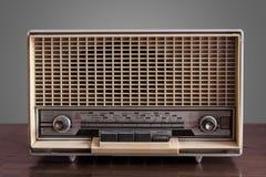 Vintage radio on grey background Royalty Free Stock Images