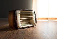 Vintage radio next to the window Stock Images