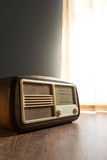 Vintage radio next to the window Stock Photo