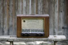 Vintage radio. Old-fashioned vintage radio on a wooden bench Royalty Free Stock Photos