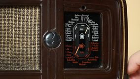 Vintage Radio. Person is tunning a very old radio machine on the european major cities frequencies stock video