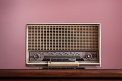 Vintage radio on pink background Stock Photography