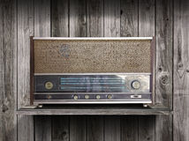 Vintage radio receiver device on old wooden Stock Image