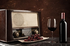 Vintage Radio and red Wine. Enjoying wine and listening to the radio Royalty Free Stock Images