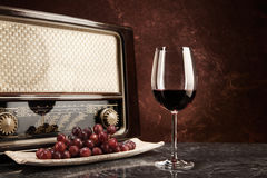 Vintage Radio and red Wine Stock Images