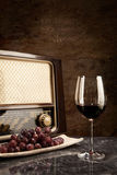 Vintage Radio and red Wine. A glass of red wine with music from the radio Stock Photo